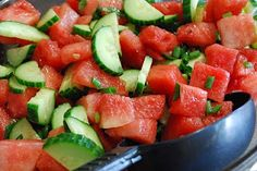 """A refreshing summer salad. You will want to make this one again and again! This one comes from Taste of Home's """"Healthy Cooking"""" magazine.    serves 16 ( 1 point)    8 c. seedless watermelon, cubed  2 medium English cucumbers, halved lengthwise and sliced  6 green onions, chopped  1/4 c. minced fresh mint  1/4 c. olive oil  1/4 c. raspberry vinegar  1/2 tsp. each salt and pepper    In large bowl, combine watermelon, cucumbers, onions and mint. In small bowl, whisk remaining ingredients. Drizzle"""