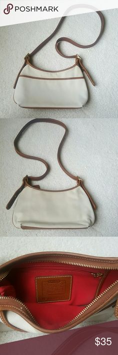 """coach purse authentic / 10.5"""" long, 6"""" tall / khaki beige and brown leather / coach chain tag and coach interior tag (with serial numer) / adjustable strap / zip top / side pocket / interior zip pocket / good used pre-loved condition / only flaws are light scratches at the bottom and the corners, as shown in photos / a classic staple! Coach Bags"""
