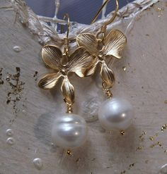 Gold flower white freshwater pearl earrings by arionjewelry