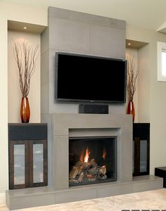 Solus block concrete fireplace surround w/wall tiles and hearth in shiitake for fireplace facade in great rrom / family room - new modern design - hdtv over fireplace w/center channel speaker