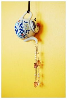 DIY Wind Chimes - DIY Teapot Suncatcher Wind Chimes - Easy, Creative and Cool Windchimes Made from Wooden Beads, Pipes, Rustic Boho and Repurposed Items, Silverware, Seashells and More. Step by Step Tutorials and Instructions http://diyjoy.com/diy-wind-chimes