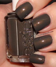 Essie Armed and Ready - I just got this color & it doesn't look like this at all.  It's more grey with glitter specs in it.  It still looks great...love it