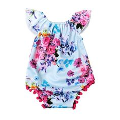 This romper is a beauty! Floral print, flutter sleeves and pretty pink pom pom details. Added bonus- snap closures for easy diaper changes! Pair it up with these adorable Baby Shoes for the perfect lo