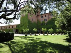Castello di San Fabiano (Tower, the Main Villa, and the Stables). Castello di San Fabiano, a red brick castle in an 11th century hamlet is wonderfully restored and unbelievably beautiful.
