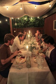 Adorable backyard dinner. Love the idea of fabric for a makeshift tent effect!