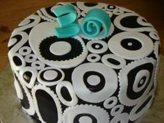 Black and White Birthday Cake - make it w/chocolate and white or coffee fondant.  Use black and whie fabric strips for design.