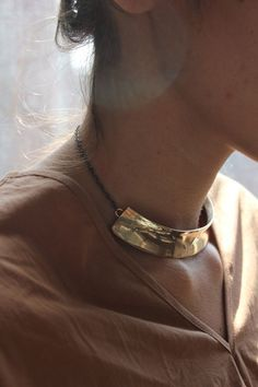 "QUARRY - HIRSHHORN SMALL COLLAR > Bronze collar, measuring 6"" x .75"", on brass chain with lobster claw closure. Made in NYC."
