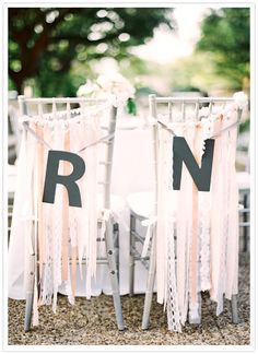 Ribbon #wedding chair signs...so pretty! From http://100layercake.com/blog/2012/10/29/romantic-houston-zoo-wedding-naomi-rachel/  Photo Credit: http://jenhuangphoto.com/