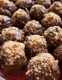 Recipe for Butterfinger Cake Balls - There is something about cake covered in chocolate and Butterfingers that people can't resist.