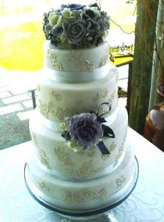 4 Tier White Fondant Wedding Cake with Edible Lace Decor and Lilac Roses