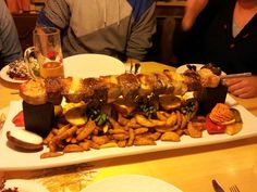 """Eifelkrimi""; medaillon of pork filet, steaks and roastbeef and as side dishes country potatoes, fries, potatoe strips and several filled vegetables - ""Vulkan Brauerei"" brewhouse in Mendig, Rhineland-Palatinate, Germany."