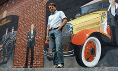 Jon Mooers painted a three-part mural in downtown Amesbury, which includes the image of Amelia Earhart next to a yellow Hudson.