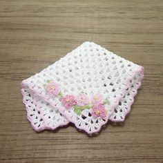 Dollhouse miniature baby crochet blanket in scale 1:12. Handmade crocheted by me with cotton sewing thread in white, it have a pink edge, and little flowers.  It measures 6.2 x 6.2 cm (2.5 inches square)    You only pay shipping for the first item in your order, any additional item ships for free in the same order.  For more info you can check my policies in here www.etsy.com/shop/MiniGio/policy