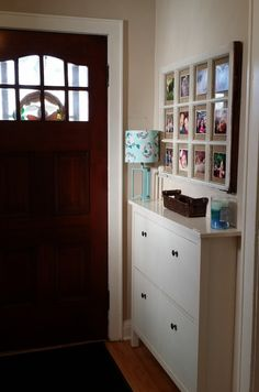Drop zone for a small front hall! Great idea to tuck it behind the door and it's the perfect spot for a key basket. It's technically a shoe cabinet, but we use it for hats, sunglasses, scarves and mittens! www.hystericallyeverafter.com