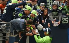 Russell Wilson Photos Photos - Quarterback Russell Wilson #3 of the Seattle Seahawks signs some autographs before the game against the San Francisco 49ers at CenturyLink Field on September 25, 2016 in Seattle, Washington. - San Francisco 49ers v Seattle Seahawks