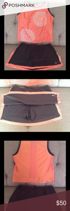 Nike Two Piece NWOT running skirt and top NWOT super cute skirt and top.  Received as gift, never worn but tags removed.  The skirt has built in shorts and is a size Small 4-6.  The top is a size medium.  Colors are dark gray and peach.  Top has cooling fabric on the back for style and comfort, as does the front underarm area.  Small darts at waist add extra style and comfort on this two piece Nike DriFit outfit. Nike Skirts Skirt Sets