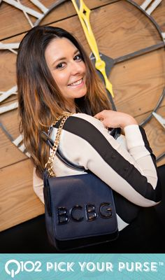 BCBG - Crossbody in Navy. Go to wkrq.com to find out how to play Q102's Pick Your Purse!