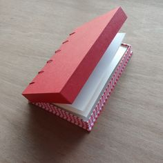 Coptic bound book with a drop back box as covers. Super idea if you want a journal you can stick things into and not worry about things falling out when you are on the go. I love the red checkers,...