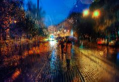 St. Petersburg-based Russian photographer Eduard Gordeev captures delicate cityscape scenes by taking photos in the rain. Flowing rain drops blur the colors and diffuse light, resulting in photos that have a strong resemblance to Impressionist oil paintings.