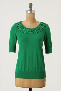 I love the color and the linked chain around the yoke of this sweater.