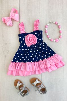Halli  Hearts Navy Have your princess the star of the show this stunning pink & navy heart ruffle dress! Perfect for everyday wear and event or pics! These are top quality and true boutique style dresses!