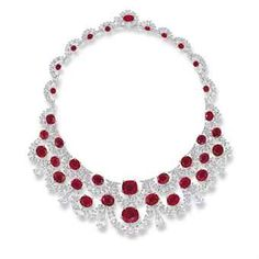 A MAGNIFICENT PIGEON'S BLOOD RUBY AND DIAMOND NECKLACE, BY ETCETERA The front designed as two rows of graduated oval-shaped diamond swags, interspersed and gathered by oval and cushion-shaped rubies, further embellished by a fringe of pear-shaped diamonds suspended by brilliant-cut diamond triangular shape surmounts, to the similarly-set back chain, joined by brilliant-cut diamond half-moon links; mounted in 18k white and yellow gold