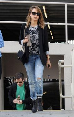 Jessica Alba style. Her long stripped socks underneath her pants really shows uniqueness in her style.