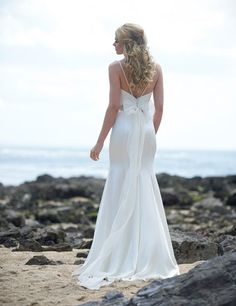Lottie is stunning in its simplicity. A beautifully cut fit & flare gown in luxurious silk satin gives an elegant silhouette, and looks great paired with a lace shrug for a versatile look. http://www.agapebridalboutique.com/collections/brides/stephanie-allin/lottie.aspx #Weddingdress #bridal #Stephanieallin #elegantweddingdress #weddingdresses #agapebridalboutique