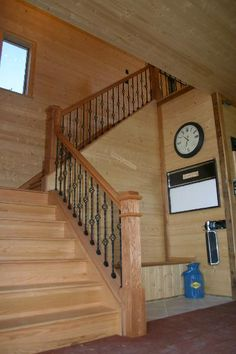 Stairs leading to second story. Loft/bedroom/office. Brick on walls, wood stair rail.