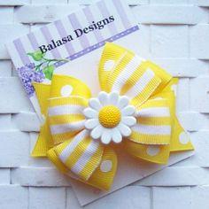 Boutique Daisy Layered Hair Bow. $3.00, via Etsy.