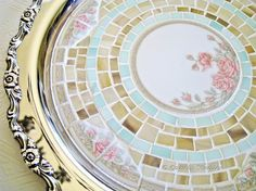 """I wish I decorated with china and silver instead of  with the """"what ever doesn't break until the children leave home"""" look.  I love this mosaic china plate!"""