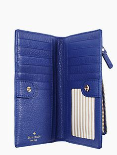 Kate Spade Cobble Hill Stacey is a bright and bold blue-purple wallet that's a perfect accessory for summer.