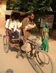 Rickshaw worker in India forced to take one-month-old baby to work after wife dies after giving birth