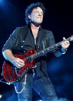 Neal George Joseph Schon is an American rock guitarist, songwriter, and vocalist best known for his work with the bands Journey and Bad English. He is Journey's only constant member, having participated in every album and tour to date.