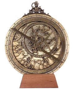 "From the Greek ""star searcher"" this instrument was introduced in Europe by the Arabs. The Astrolabe was a vital tool for astronomers, astrologers and surveyors. Steampunk Furniture, Instruments, Nordic Tattoo, Skeleton Watches, Coin Jewelry, National Museum, Compass, Old Things, Manly Things"