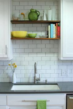 If you only want a few open shelves (to display cookbooks and a few pretty pieces), try adding open shelving just over the sink | In the Mix: 20 Kitchens with a Combination of Cabinets and Open Shelving