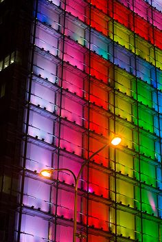 Modern Lit Condo Building Architecture Led Lights in colorful rainbow.  Glowing multi color facade of building.