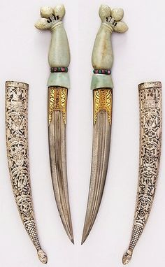 Indo-Persian jambiya dagger, 19th century, Indian hilt, Ottoman blade, steel, jade, silver, emerald, ruby, gold, H. with sheath 14 9/16 in. (37 cm); H. without sheath 13 3/8 in. (34 cm); H. of blade 7 1/2 in. (19.1 cm); W. 2 3/8 in. (6 cm); Wt. 7.3 oz. (207 g); Wt. of sheath 2.4 oz. (68 g), Met Museum, Bequest of George C. Stone, 1935.