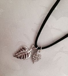Pewter Pine Cone and Leaf Charm Necklace with Black Suede Leather Cord by Stella & Ellie, $12.00