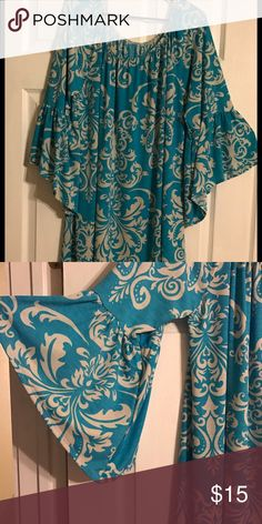 Flowing blue shirt Fits loose never work like new with out tags Tops Blouses