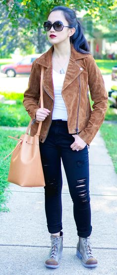 Woman wearing white tee, Brown BlankNYC suede jacket, black Express distressed jeans, brown Naot laceup boots, Tiffany & Co. sunglasses, and cammello Mansur Gavriel bucket bag! suede jacket outfit | suede jacket women | fall outfits | casual fall outfits | lace boots outfit | #fallfashion #fallstyle