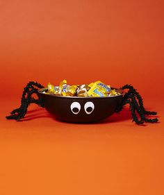 It's easier than you think to transform a candy bowl into a spider for Halloween. Get the easy DIY for this creepy creature at RealSimple.com.