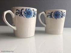 Items similar to Alfred Meakin / Glo White Ironstone / tea set / 2 cups, jug & bowl / stylised shades of blue floral design / tea for two / vintage on Etsy Alfred Meakin, Tea Set, 1940s, Cups, Unique Jewelry, Tableware, Handmade Gifts, Etsy, Vintage
