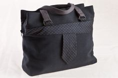 """A tote bag """"Tuuri"""" by Finnish fashionbrand Globe Hope. The bag is decorated with a men's necktie. GH makes bags, accessories and clothes from recycled materials for example a very durable army surplus materials."""