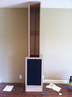 cabinet to conceal speakers in home theatre