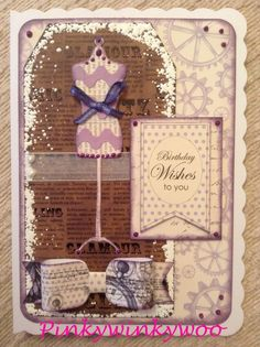 Birthday card for a lady/woman. Craftwork cards paper, tag, bow & sentiment. Memory box mannequin die, frantage, Tim Holtz distress ink & ribbon. Purple perfect pearls.
