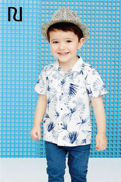 This kids-sized white floral print button down short sleeve shirt is the perfect spring outfit addition for your little guy. Click to shop this adorably handsome piece at River Island for only $20!