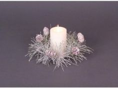 """Pack of 12 Snow Drift White/Green Iced Pine/Cone Christmas Candle Rings 12"""" by CC Christmas Decor. $69.99. From the Snow Drift CollectionItem #44172Features green pine needles dusted with white faux snow and dispersed with pine conesHolds pillar candlesFits 3"""" candleNote: Candle rings only - candles NOT included Dimensions: 12"""" diameterMaterial(s): plastic/naturalPack includes 12 of the candle ring shown. Save 18% Off!"""
