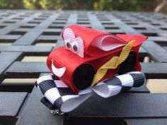 A Disney Cars inspired hair bow I made for my daughter.  Who says girls can't love cars?