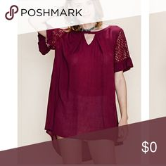 "Clearance💥Merlot Short Sleeve Tunic Shirt Merlot Short Sleeve High Low Tunic. Tunic has keyhole front design. Beautiful Lace trim detail with high low design. Non lined. Also available in burgundy. 100% Rayon. Extra Button provided with top. Bust underarm to underarm on Medium measures 24"" great relaxed fit easy to dress up or wear casual. Tops Tunics"